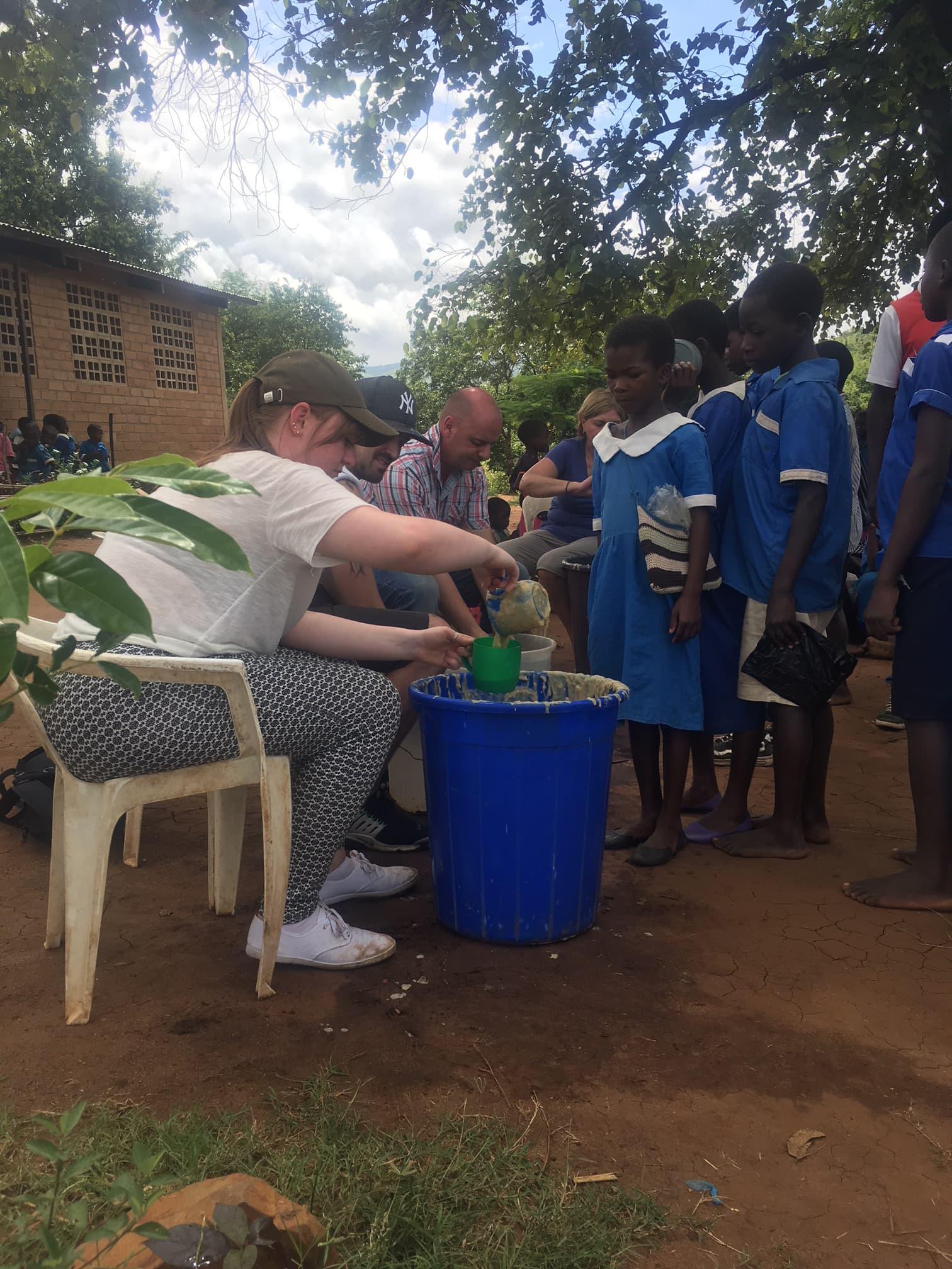 Helping with breakfast time at Nasundu School