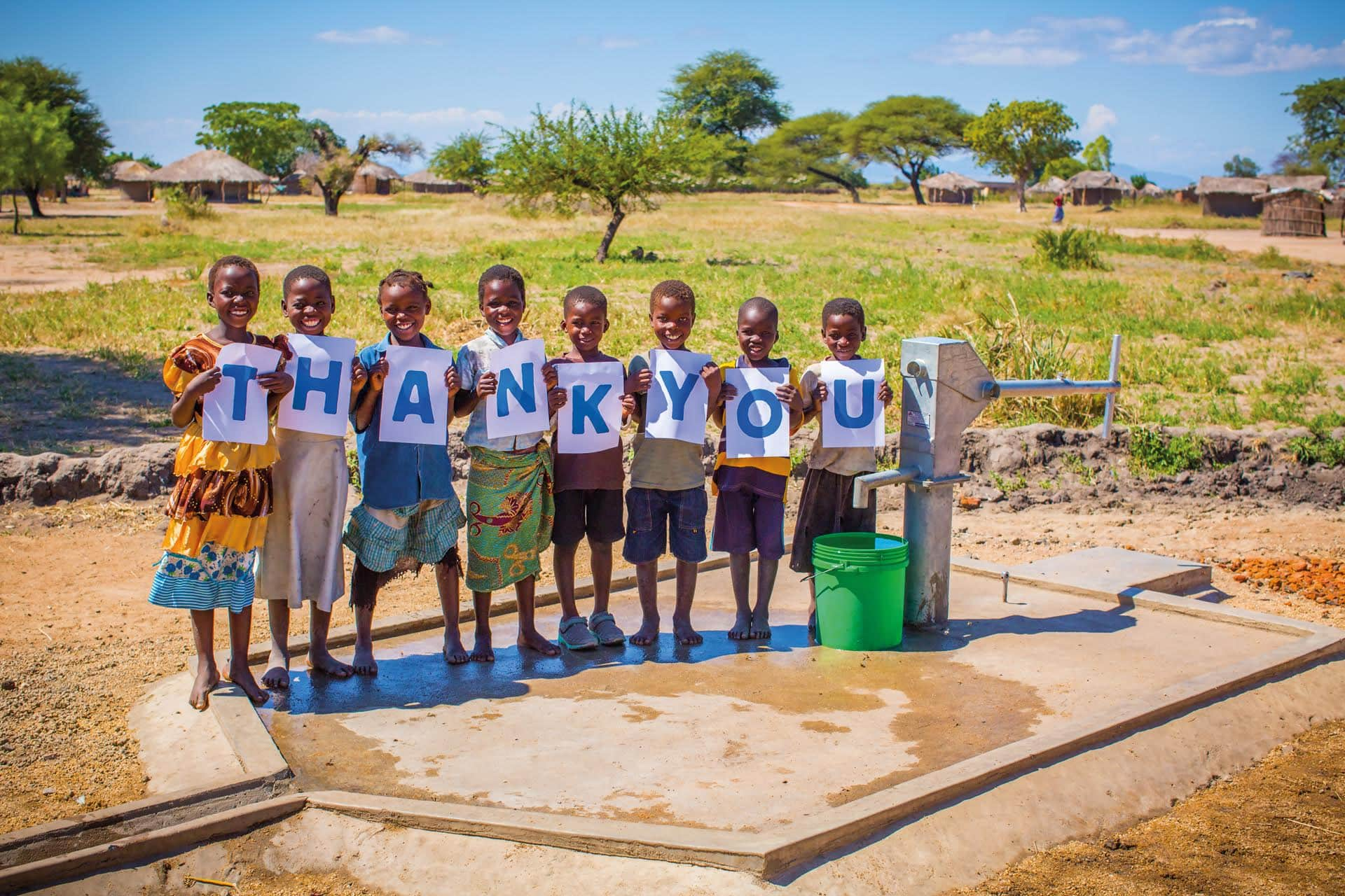 Children holding thank you sign