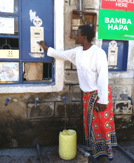 Lilian collecting water from a local tap