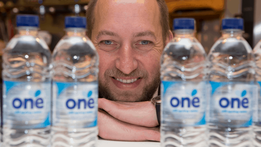 Duncan with bottles of One Water