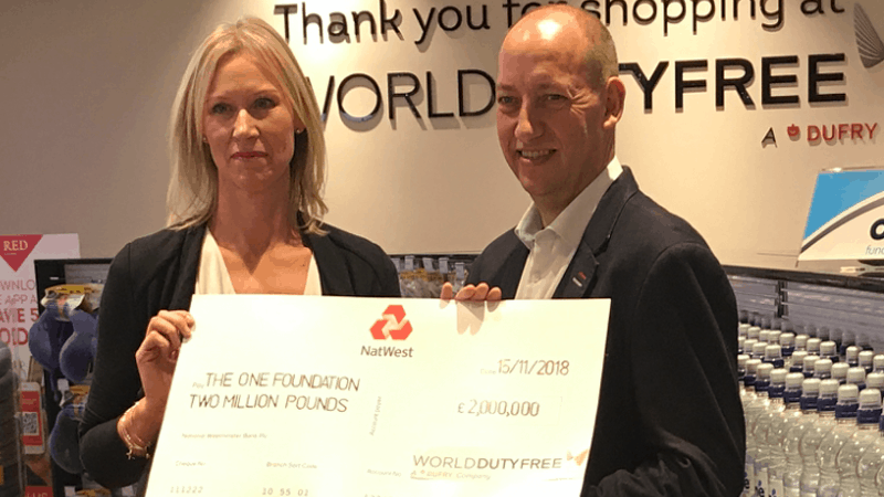 Duncan receiving cheque from World Duty Free for £2 million