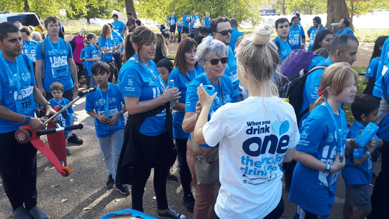 Sarah handing out 'One Less Bottle' at Race for the Kids 2018