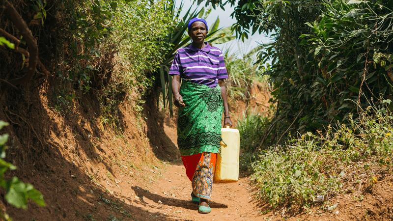 Didacienne collecting water