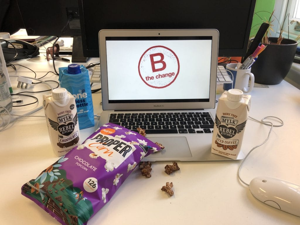 Photo featuring Propercorn popcorn, Rebel Kitchen drinks, One Water and the B Corp logo