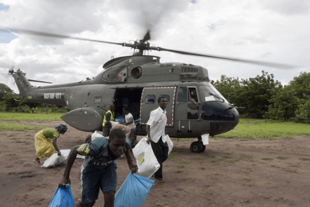 Supplies being dropped by helicopter into disaster-stricken area