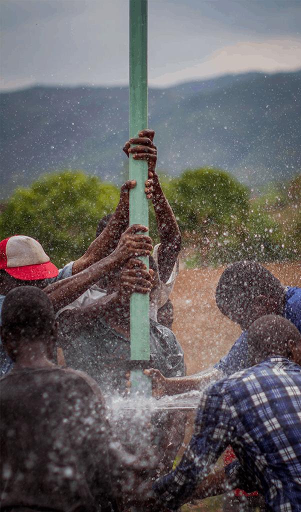 Men repairing a faulty water pump