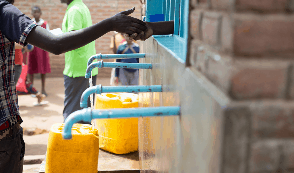 Paying for water at a community water point in Nairobi