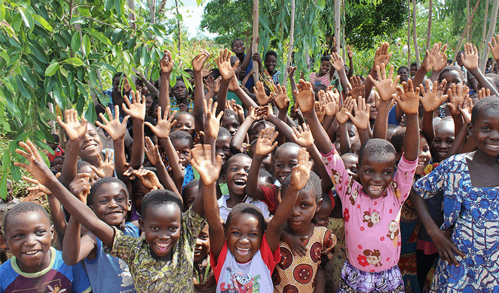 Children with their hands up, celebrating